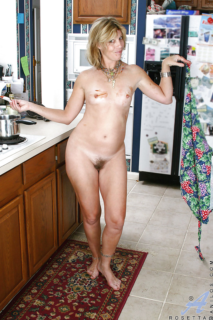 Naked mature women in kitchen