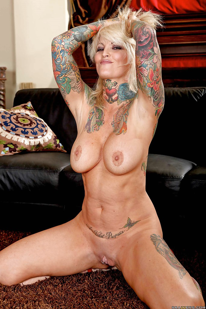 Tatooed mature pornstar nikita
