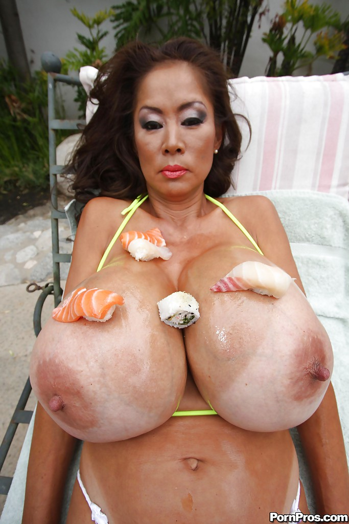 Asian mom with huge tits Minka exposing her melons in ...