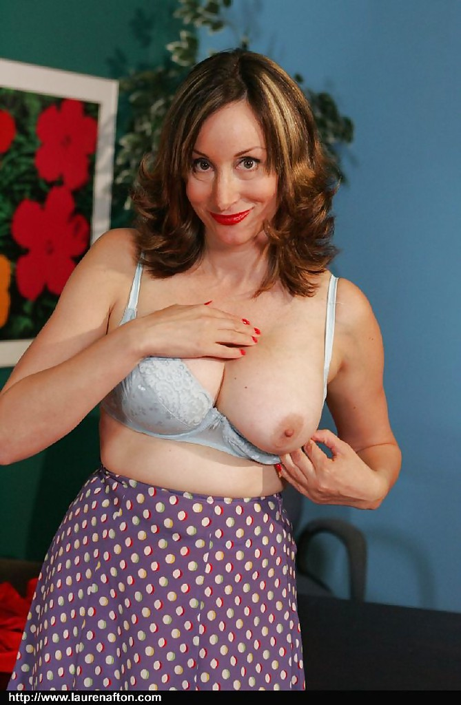 Seductive mature babe Abigail Fraser uncovering her big round tits ...