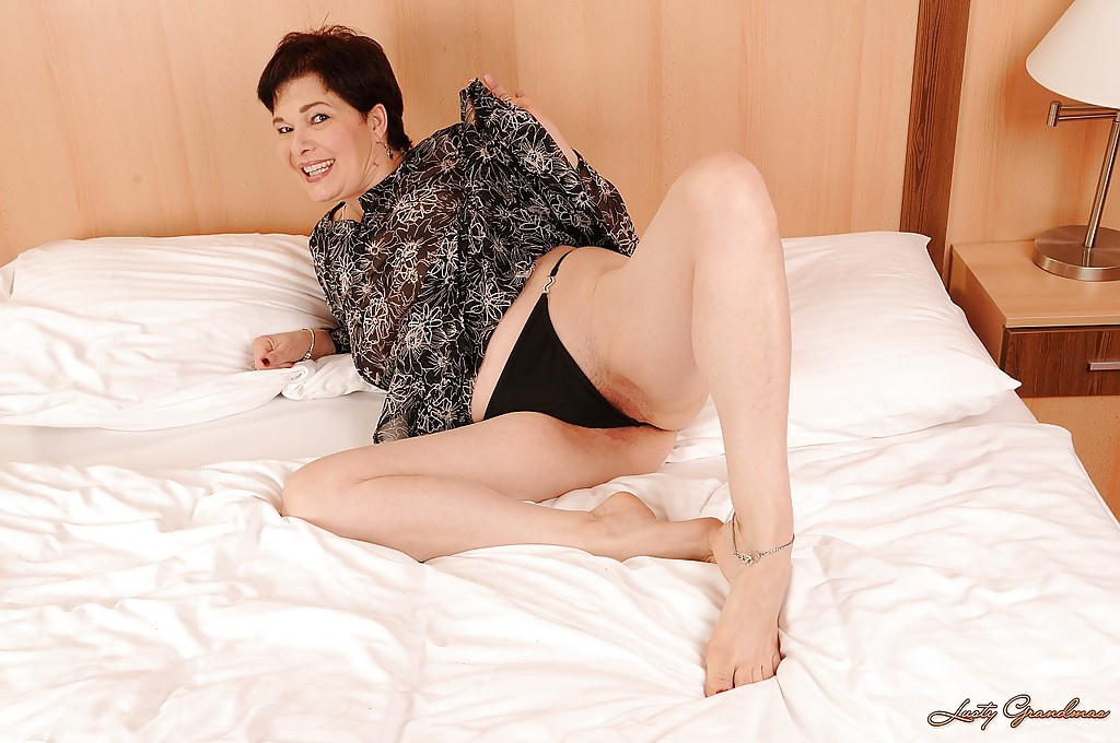 mature woman naked on the bed