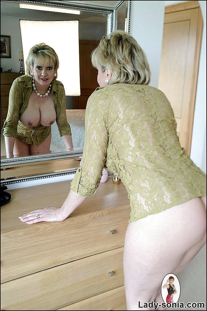 image Mature lady stripping in the kitchen