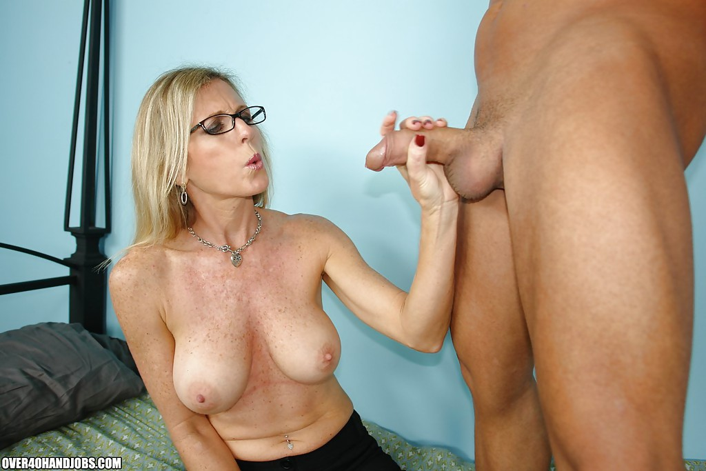 super fat blonde handjob gives