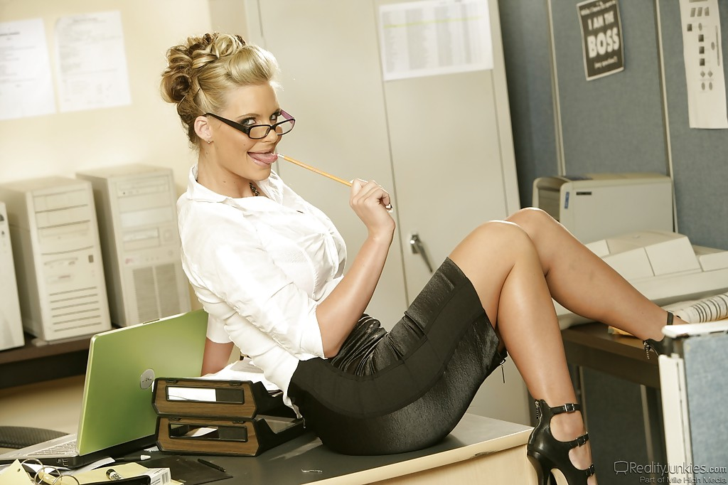 Gorgeous blonde mommy Phoenix Marie stripping in her office  2210451