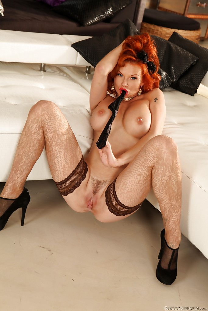 Leggy redhead stockings