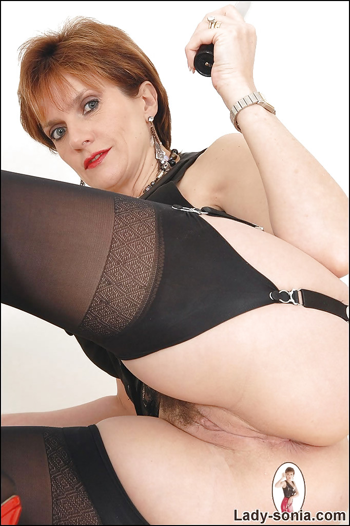 Mature in stockings with her dildos