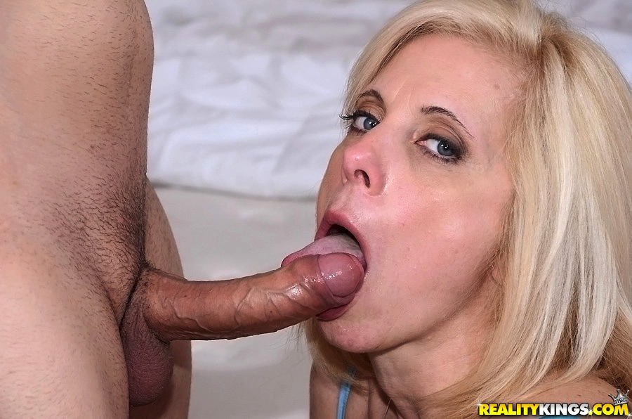 image Busty blonde gets jizz in her mouth