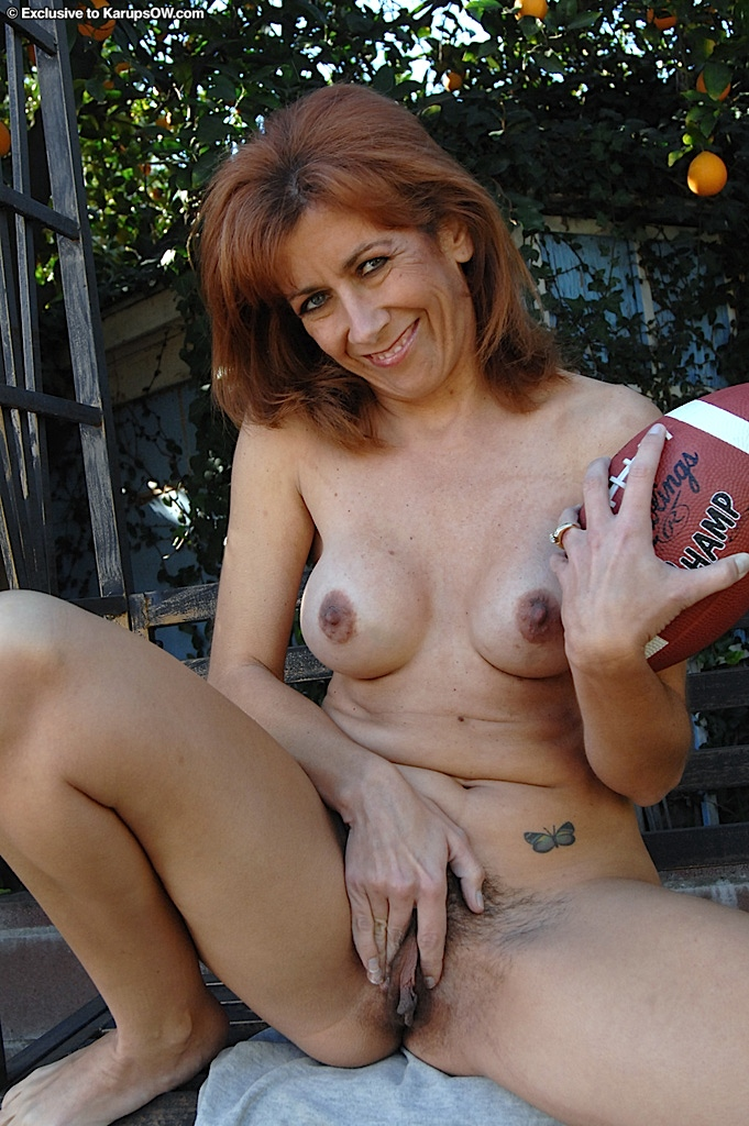 Lusty mature lady undressing and exposing her hairy gash ...