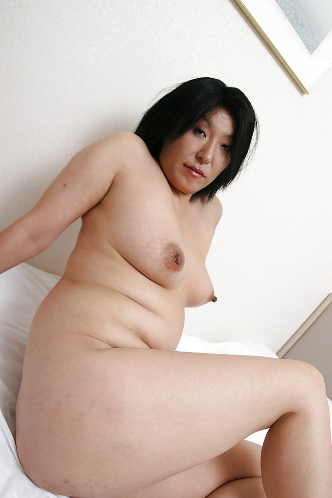 naughty mature asian lassie undressing and spreading her