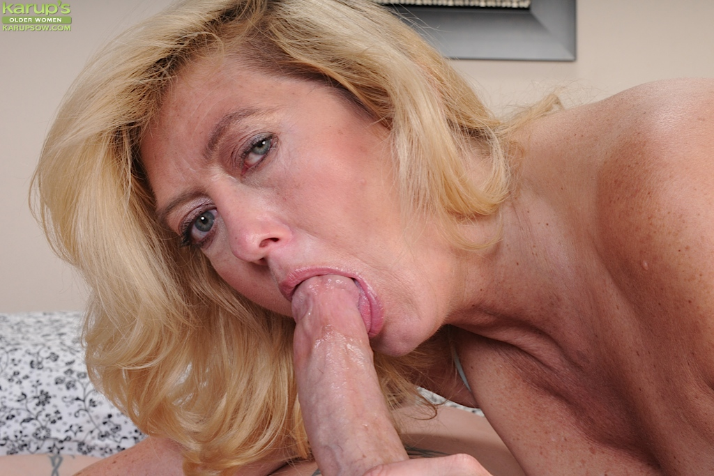 image Blonde slut gives head and enjoys sucking while he cums