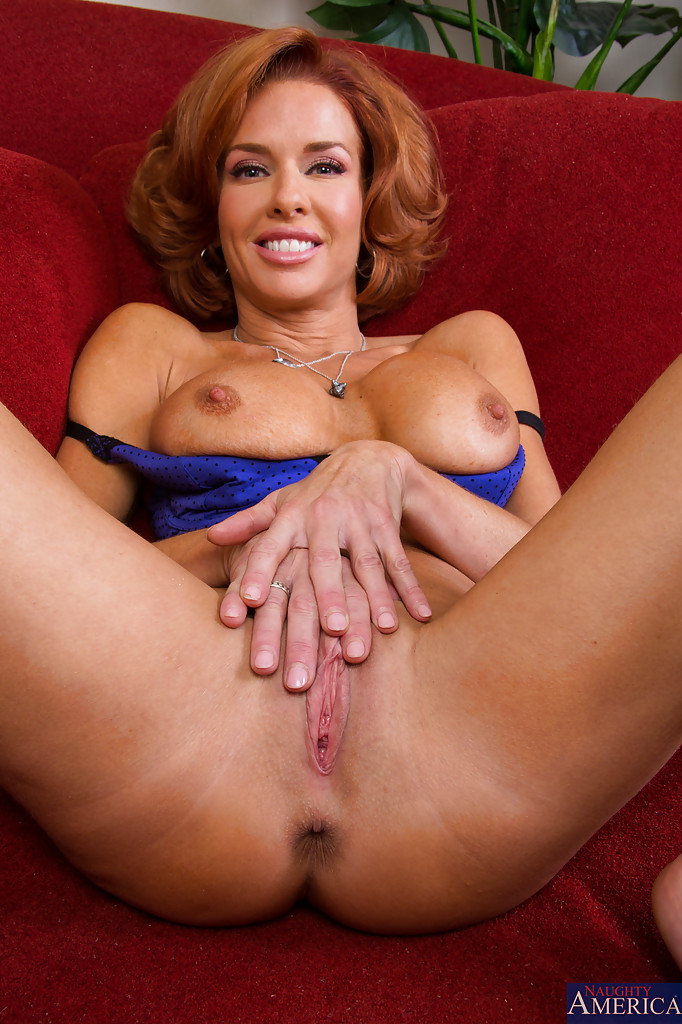 Redhead milf enjoys stroking a coc something is