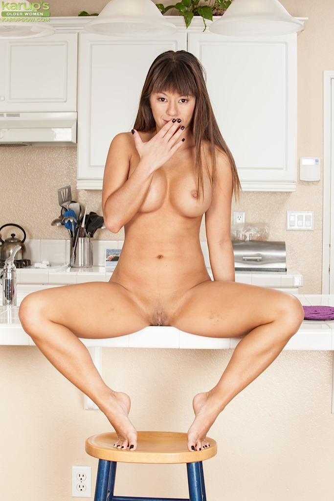 Asian milf nikko jordan is on her knees and blowing a geek