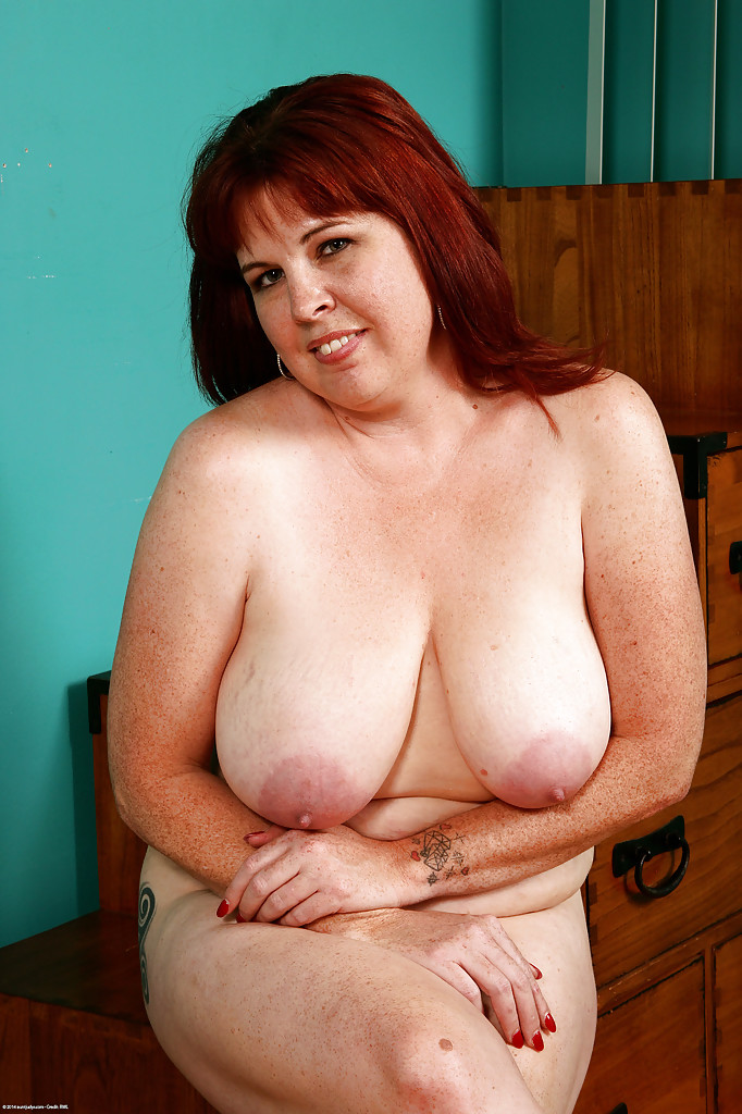 Mature cinna page gets naked in the kitchen 5