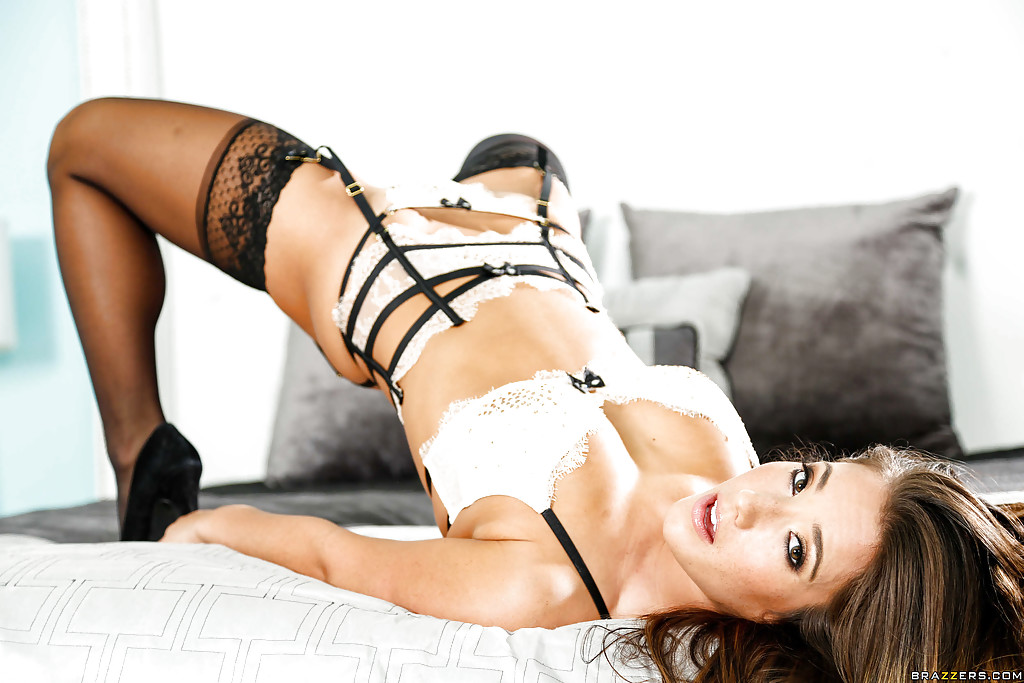 Stunning brunette Eva Lovia plays with her hot tanned boobies  1590002