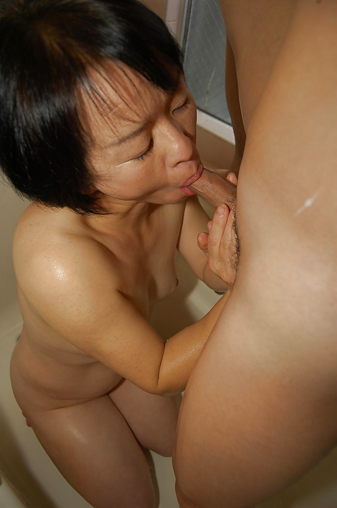 Oriental preggo has breasts fondled
