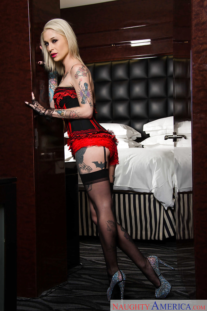 Tattooed blonde Kleio Valentien removing riding cap and clothes to pose naked  1192378