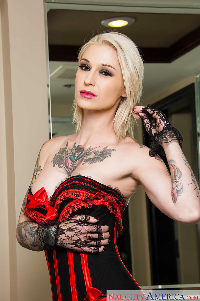Tattooed blonde Kleio Valentien removing riding cap and clothes to pose naked  1192354