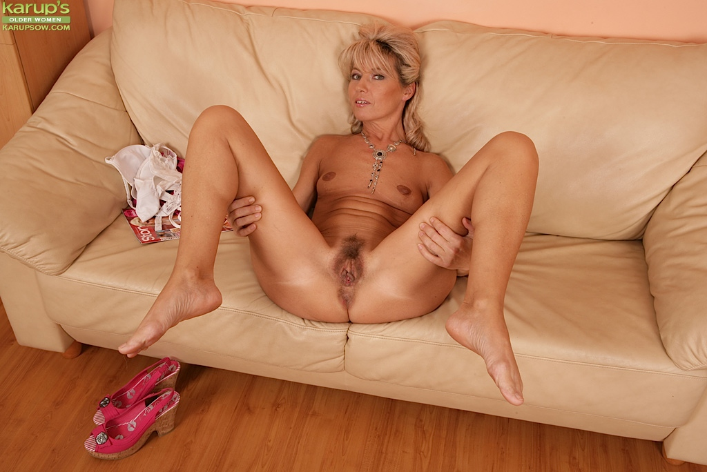 Mature cutie Janet Darling baring small breasts and ...