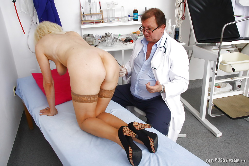 Horny doctor examines her boobs