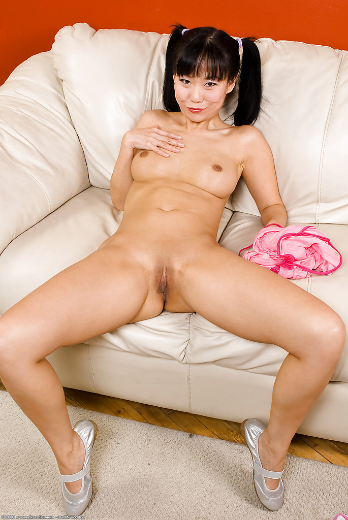 Masturbating asian with pigtails gives a bj