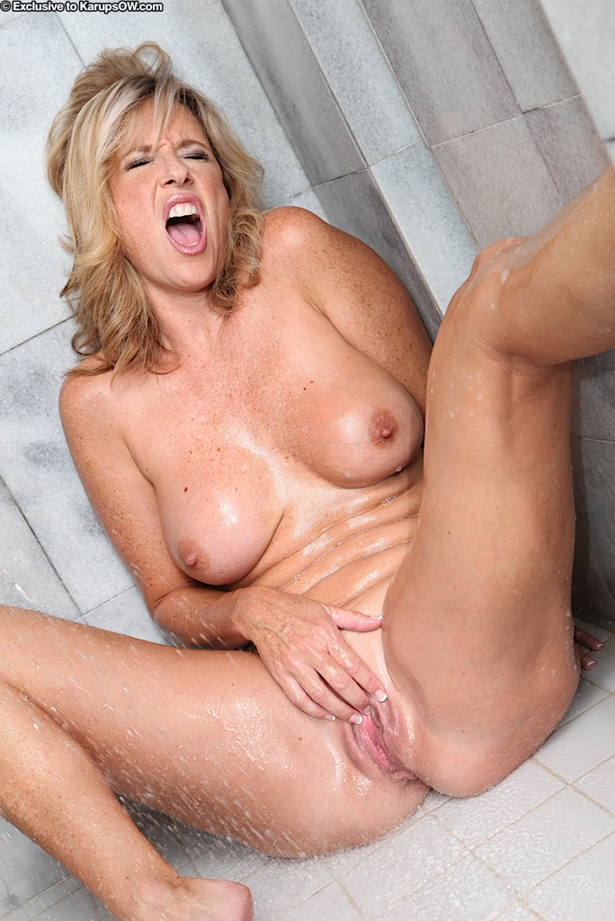 Mature women in shower tube