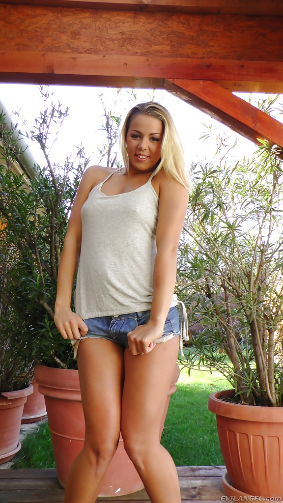 Blonde solo girl Christen Courtney removing shorts and panties on patio  473058