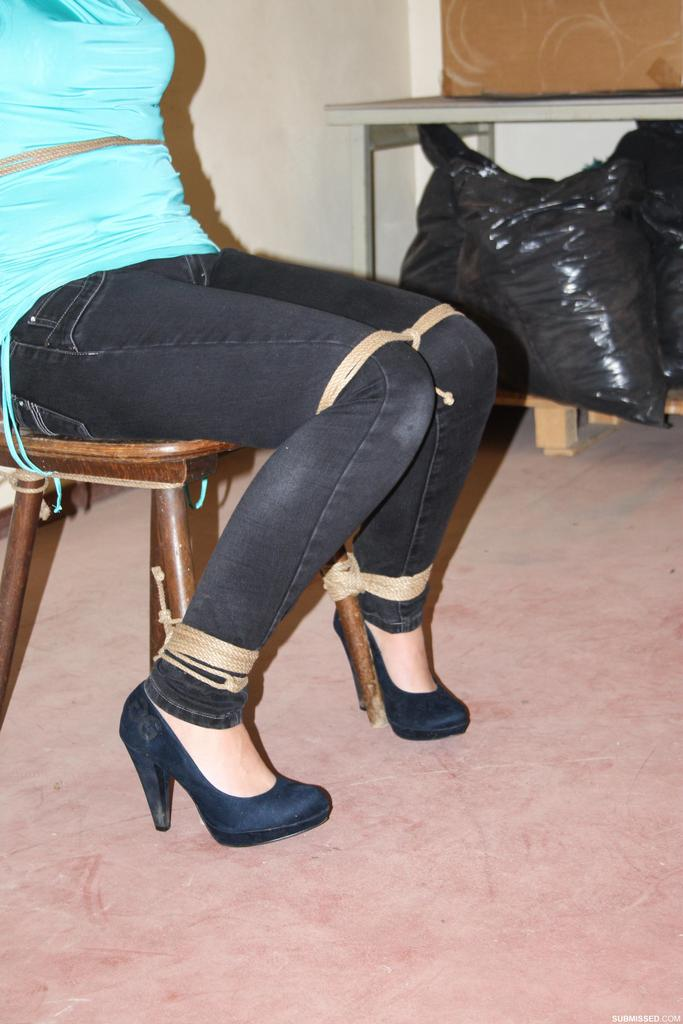 Brunette chick Isabella Chrystin is left tied to a chair with her tits exposed  1668485
