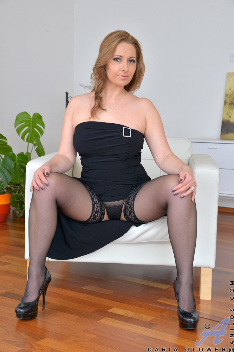 Housewife in high heels and stockings undressing to bare ...