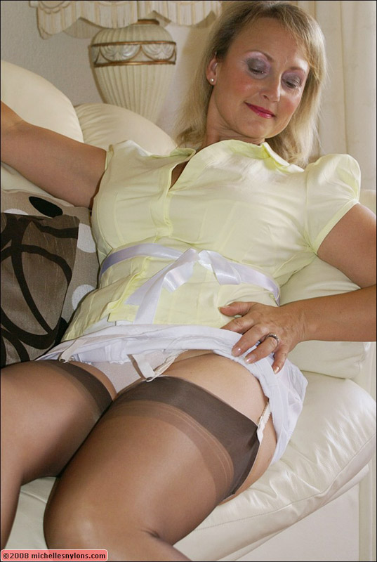 Mature in stockings playing with her panties