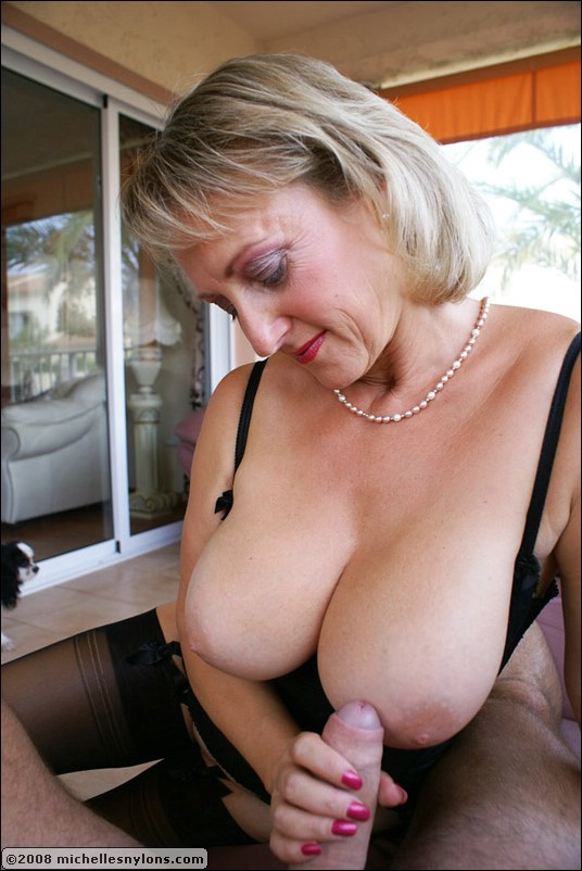 Milf holding their tits in their hands
