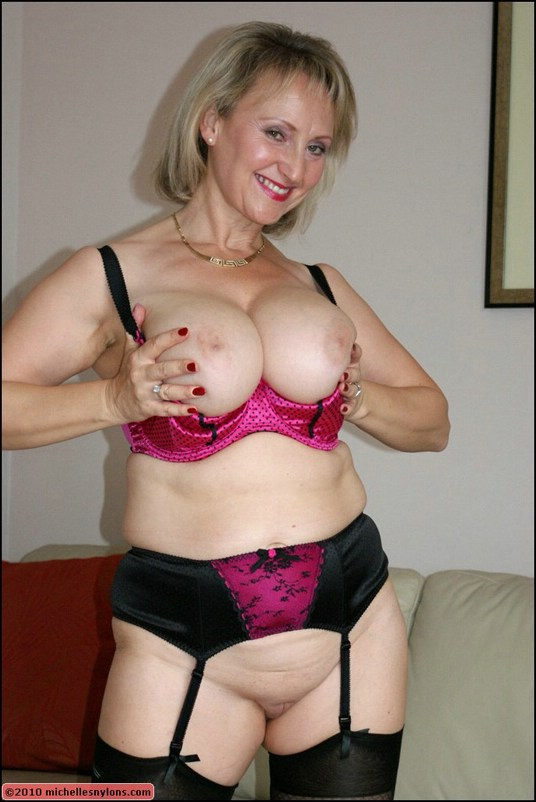 Old blonde with fat ass and huge tits posing in stockings and sucking a dick