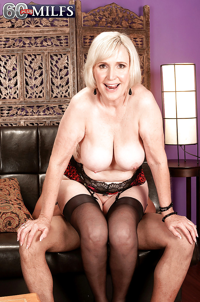 Mature blonde in white hold ups fucks