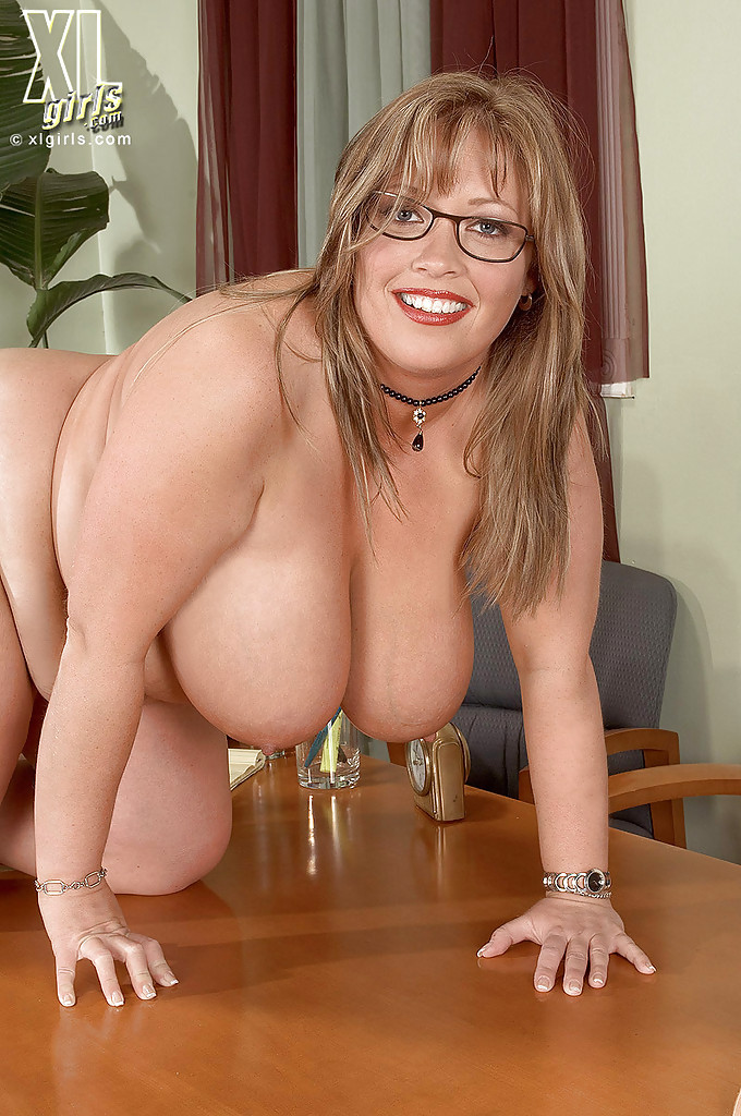 Horny mature with glasses toying in office