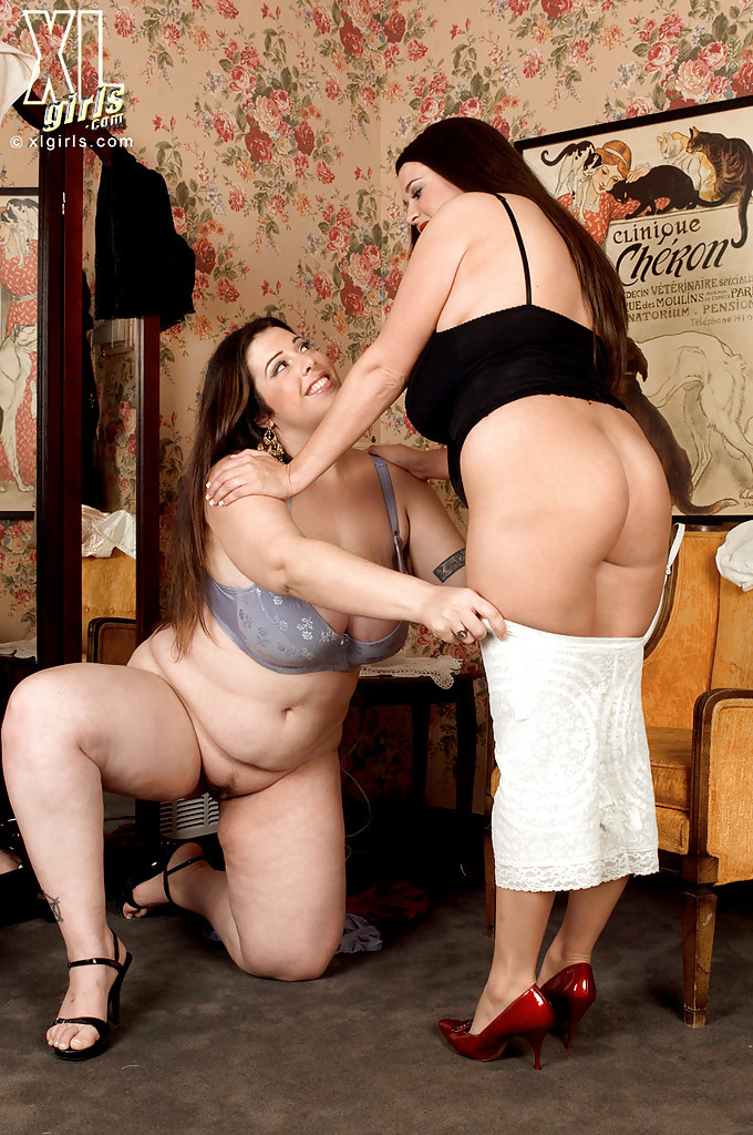 Two chubby babes in sexy lingerie showing their fat tits and ass