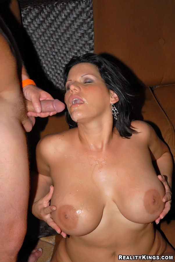 Woman playing with big dildos