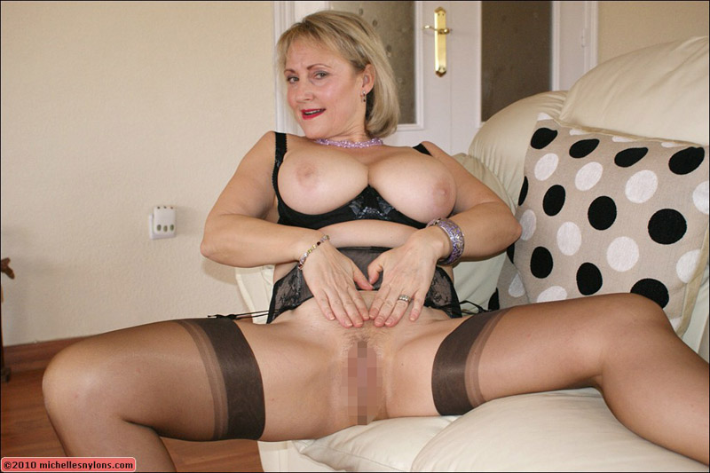 Blonde milf legs spread on couch