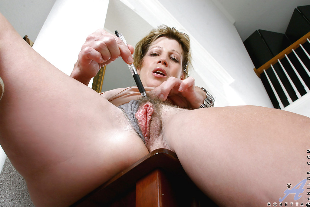 Not wet mature pussy with large clitoris remarkable, this