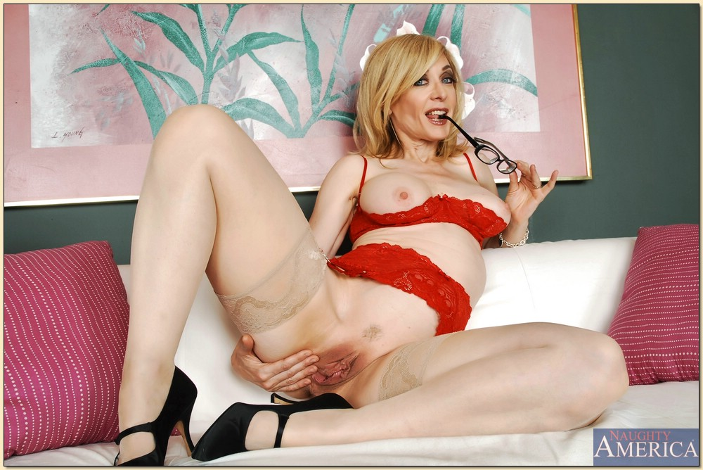 Nina hartley spreads legs and pussy something is