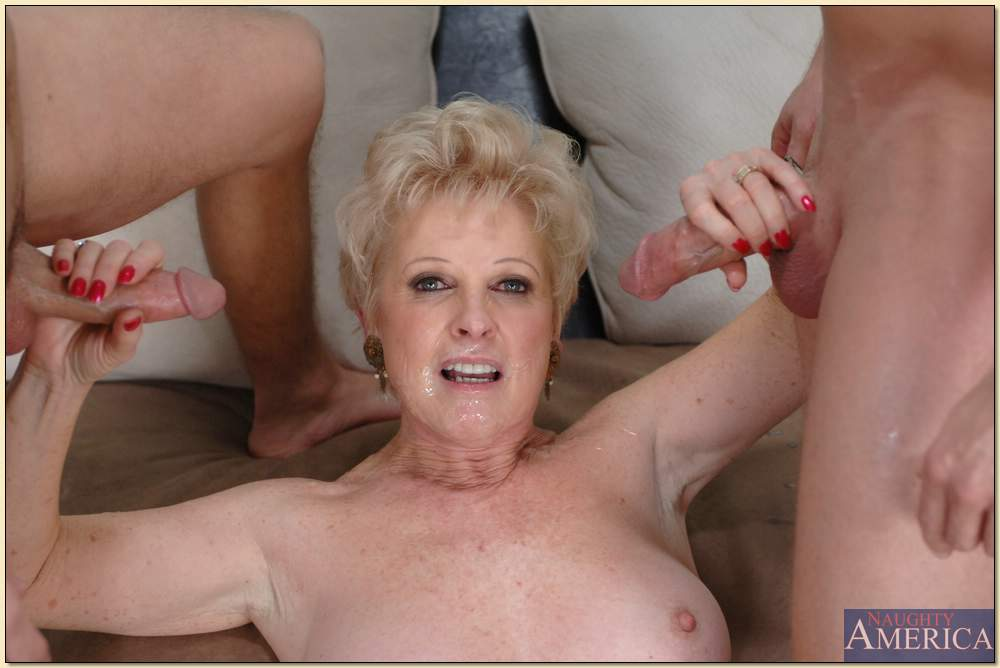image Granny swallows two cocks in the fields