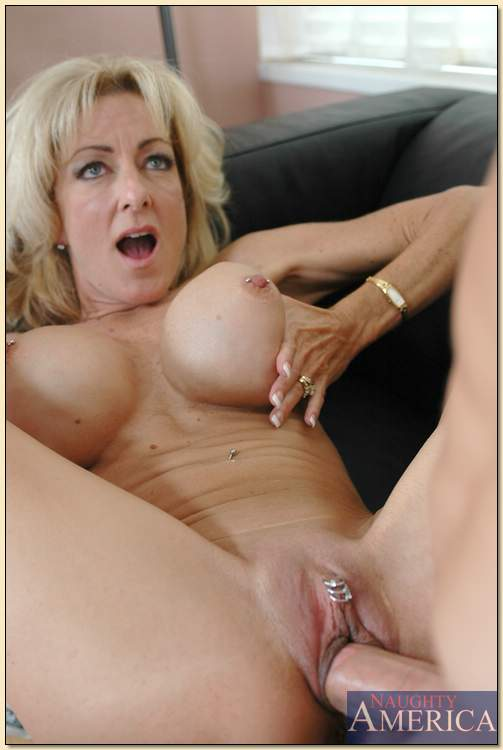 Mature holds tits