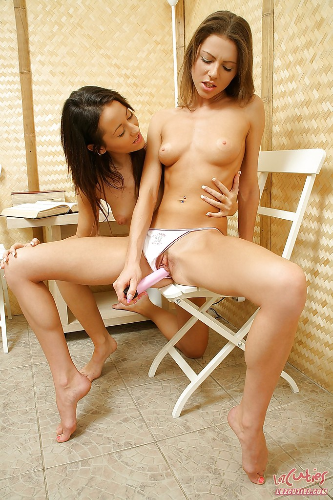 Lusty teen lesbians revealing small tits and toying tiny assholes