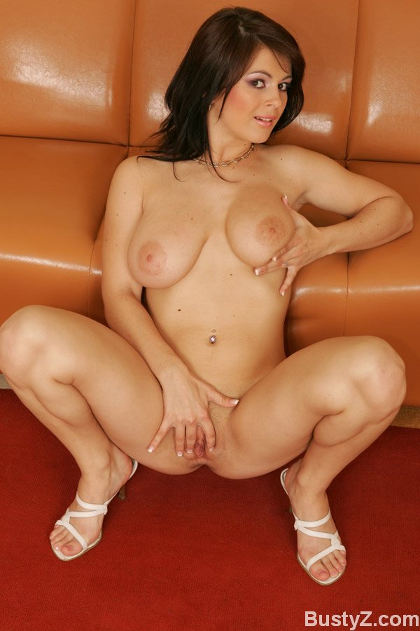 MILF babe with huge tits Anya spreading her shaved juicy cunt
