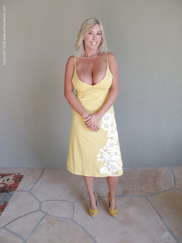 mature blonde wife with huge tits shows off her gorgeous body