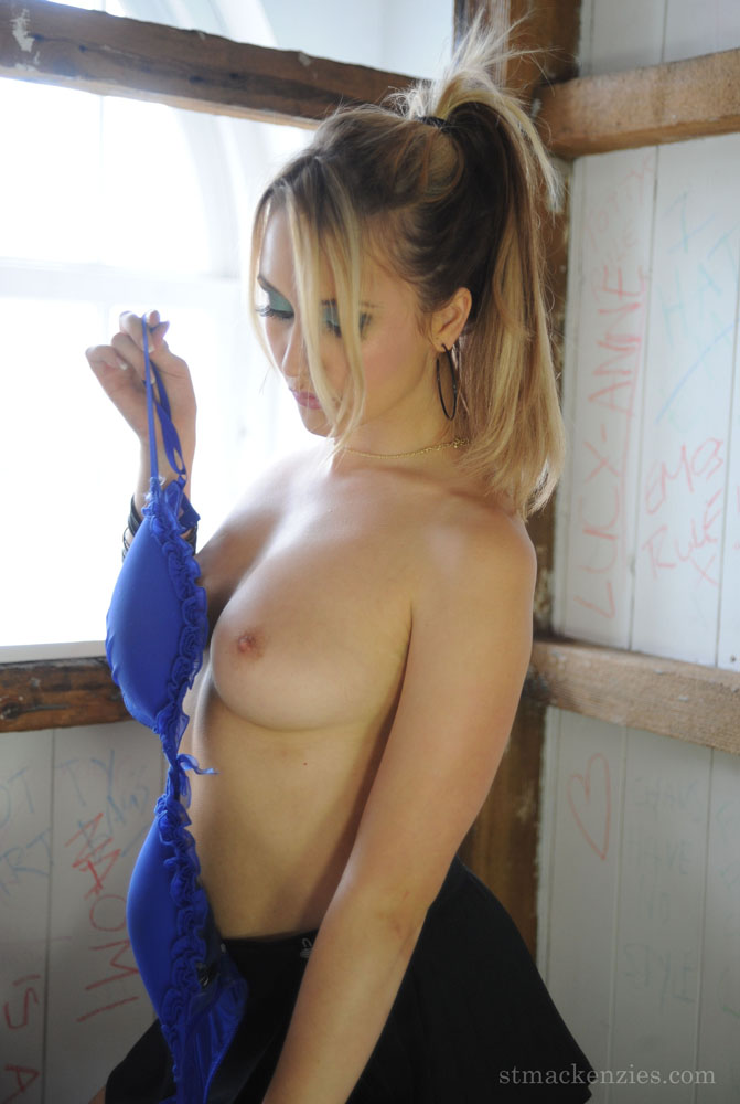 Sexy babe Cat OConnell smoking and stripping off lingerie