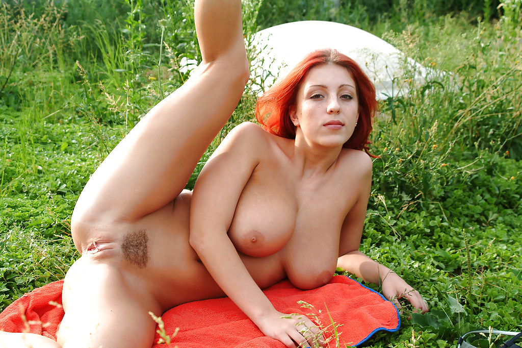 ... Teen redhead Ashley showing off her big boobs and tight pussy outdoor  ...