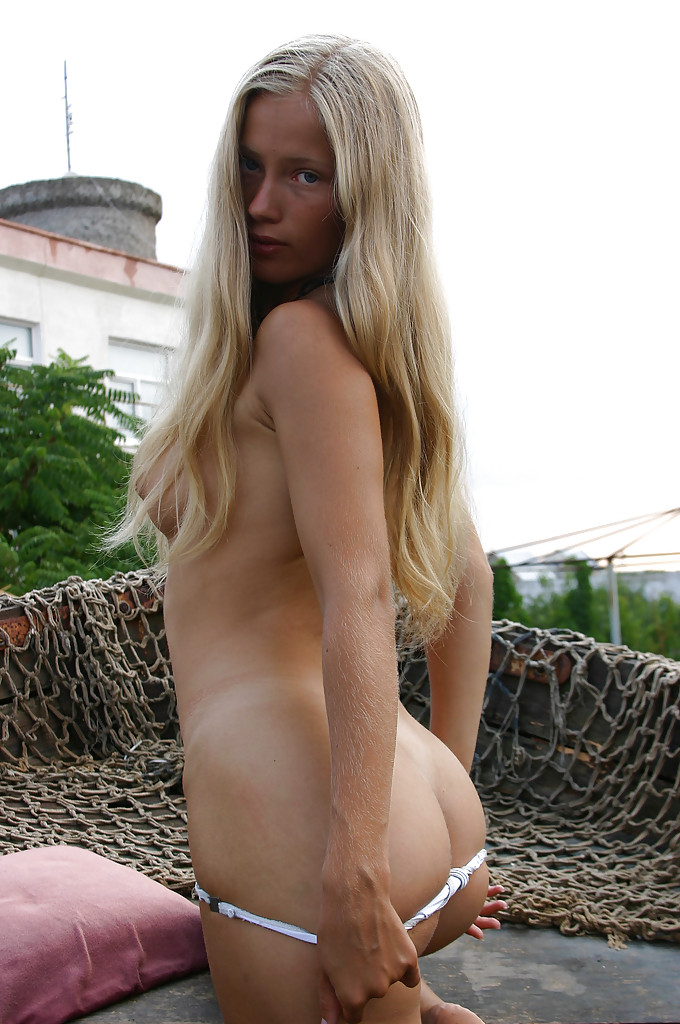Hot Babe With Fuzzy Ass And Tiny Tits Eva H Posing Nude Outdoor