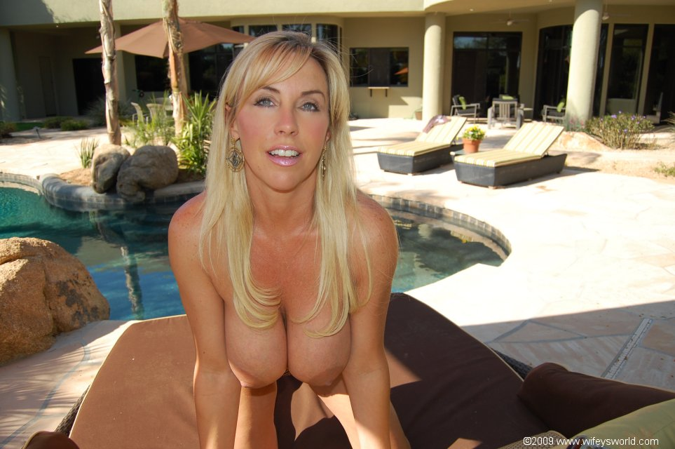Fuckable busty MILF Wifey stripping and posing by the pool