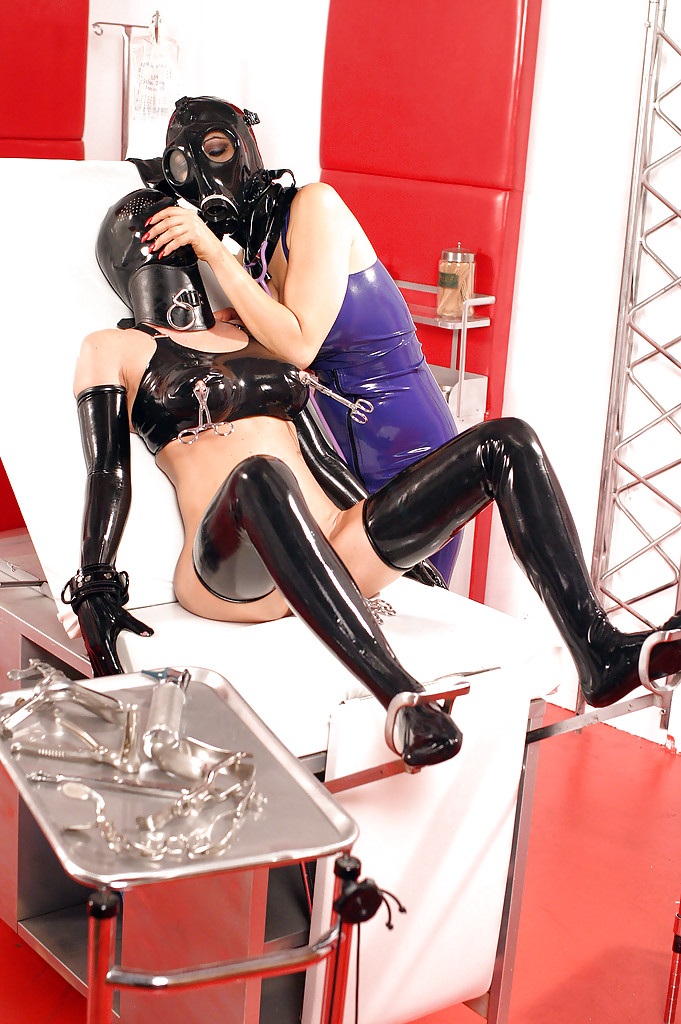 Three gorgeous babes in latex outfits are into kinky ...