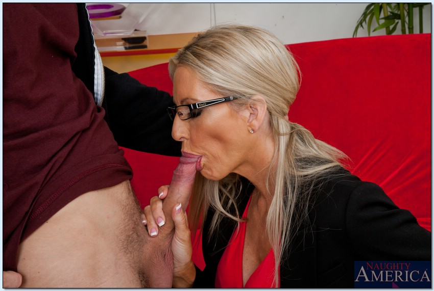 image Glasses wearing milf fucks pussy with toy