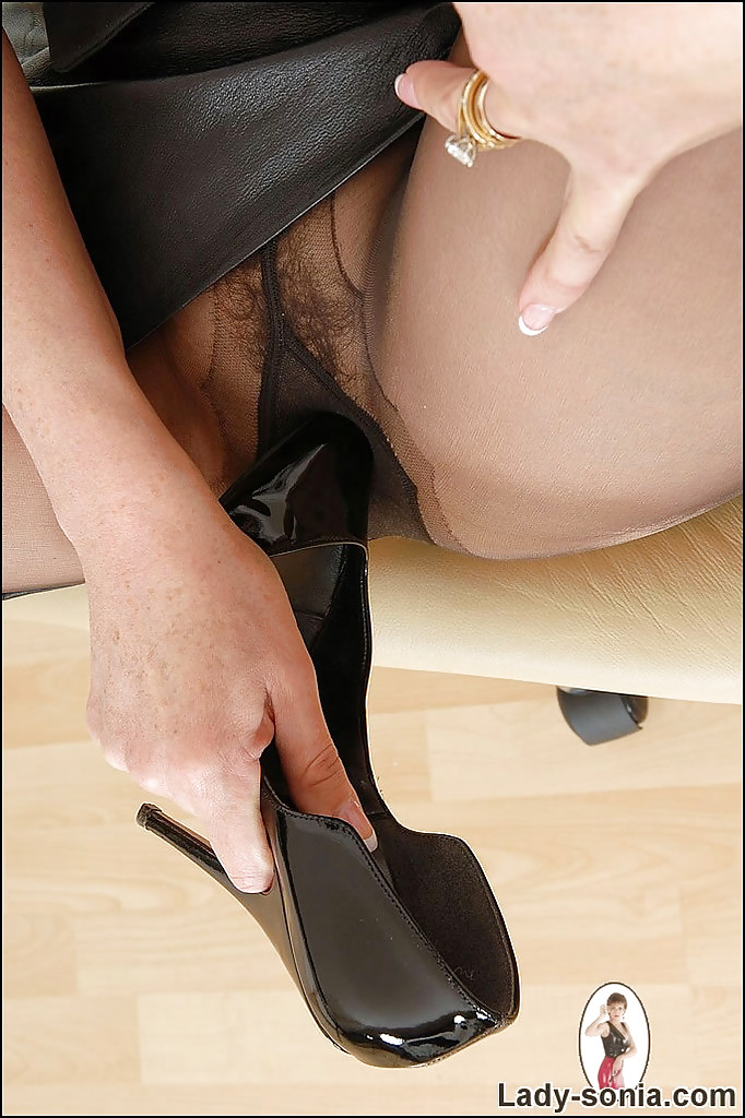 mature lady in pantyhose spreading her legs and teasing